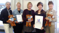 Left to right: Suzanne Ingrao, Bev Slansky, (co-chairs of the Hug-a-Bear program), Sheri Rouse Chadwick Center, chapter President Joyce Bressler and philanthropic programs Vice President Wendy Morris. (Courtesy photo)
