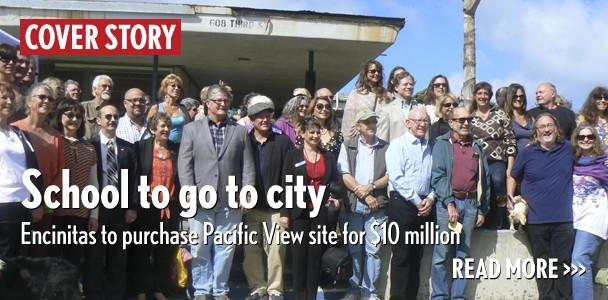 Key supporters pose for a picture March 27 in front of Pacific View school's entrance. (Photo by Ellen Wright)