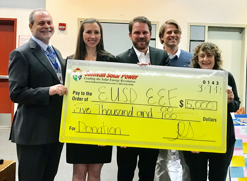 The Encinitas Educational Foundation receives a $5,000 donation March 7 from Sullivan Solar Power. Left to right: Encinitas Union School District Superintendent Tim Baird, Tara Kelly and Daniel Sullivan of Sullivan Solar Power, foundation President Jay Bell and district board Trustee Marla Strich. (Courtesy photo)