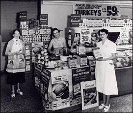 Sophie Cubbison, center, at a supermarket demonstration. (Photo courtesy of Mrs. Cubbison's Foods)