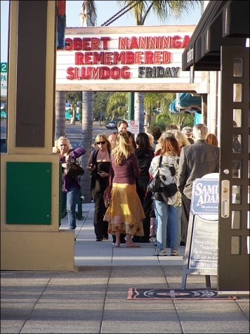 Community members wait outside La Paloma Theatre in Encinitas on March 12 before a memorial for activist and artist Bob Nanninga, who died in February. (Photo by Scott Landheer)