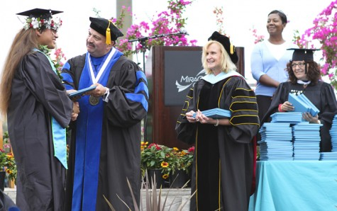 MiraCosta College Superintendent/President Francisco Rodriguez (left) congratulates a student as Vice President of Instructional Services Mary Benard (center) looks on during commencement ceremonies May 17. (Photo courtesy of MiraCosta College)
