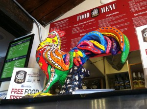 This chicken sculpture, pictured Aug. 15 at Old California Coffeehouse and Eatery in San Marcos, is part of the community's Chicken Parade event running through Sept. 30. (North Coast Current photo)