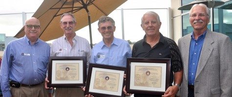 Jerry Pendzick of the Federal Aviation Administration (far left), stands with Wright Brothers Master Pilot Award recipients Rock Swanson, John Graybill and Stu Evans, and Steve Nelson (far right), also of the FAA, on July 10 at Palomar-McClellan Airport in Carlsbad. (Photo courtesy of the Palomar Airport Association)