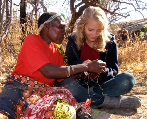 Grauer School student Natalie Brooks (right) works with a tribal member in Tanzania. (Grauer School photo)
