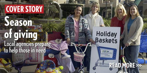 Volunteers+help+in+the+Encinitas-based+Community+Resource+Center%E2%80%99s+Holiday+Baskets+drive+at+the+Del+Mar+Fairgrounds+last+year.+%28Community+Resource+Center+photo%29