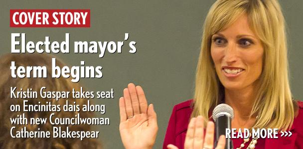 Encinitas Mayor Kristin Gaspar is sworn into office by City Clerk Kathy Hollywood on Dec. 9. (Photo by Scott Allison)
