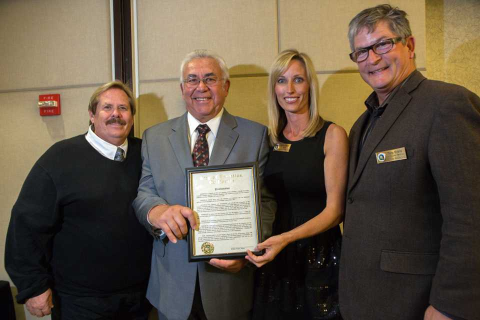 Pictured to left to right are: Councilman Mark Muir (left), Encintas Chamber of Commerce CEO Bob Gattinella, Mayor Kristin Gaspar and Councilman Tony Kranz mark the chamber's 50th anniversary Nov. 7 at the Encinitas Community Center. (Encinitas Chamber of Commerce photo by Bill Wechter)