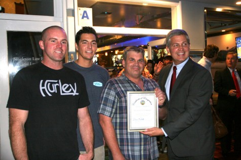Pillbox Tavern & Grill co-owners Justin LaFrantz, Mike Garcia and Leigh Gibson celebrate the eatery's grand opening Dec. 10 with county Supervisor Dave Roberts (far right). (Photo by Manny Lopez)