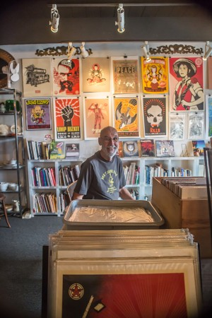Jerry Waddle, owner of Ducky Waddle's Emporium, is pictured May 29 among his Leucadia store's eclectic mix of used books and cutting-edge art. (Photo by Jen Acosta)