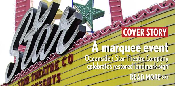 The Stare Theatre's restored marquee is lit July 3 in Oceanside. (Photo by Troy Orem)