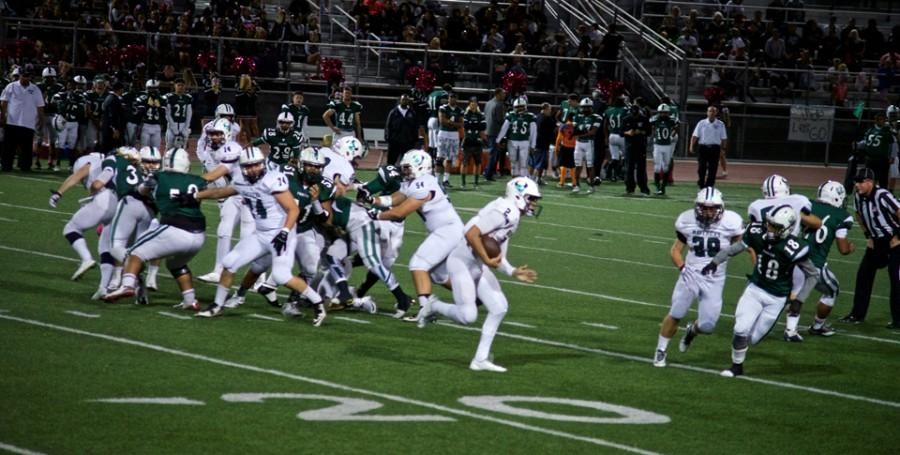 La Costa Canyon High School junior Tanner Clark runs the ball during the Oct. 30 game against Oceanside High School at Oceanside's Simcox Field. Oceanside won the game 22-7. (Photo by Troy Orem)