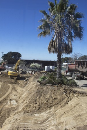 Crews work on the site of San Dieguito High School Academy's future math and science complex, pictured through a wall portal Feb. 11. (North Coast Current photo)