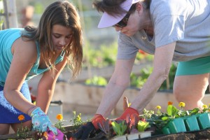 Family members tend a plot Feb. 12 at the Encinitas Community Garden. (Photo by Jen Acosta)