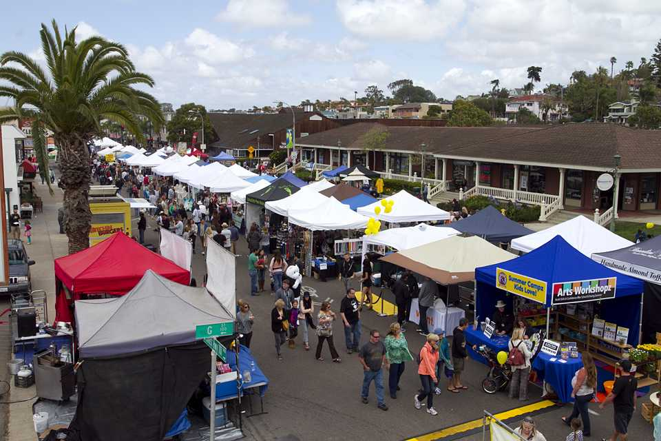 Visitors peruse vendors at the Encinitas Spring Street Fair, viewed from atop the Rock2You rock climbing wall at the corner of G Street and South Coast Highway 101 on April 26, 2014. (NCC file photo by Scott Allison)