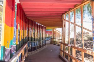 """Over the past year, students have created murals along the wall of what has become known as the """"tunnel,"""" a walkway separating construction and safe passage at San Dieguito High School Academy in Encinitas, pictured Sept. 15. (Photo by Jen Acosta)"""
