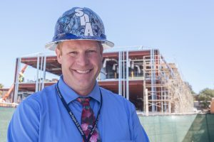 San Dieguito High School Academy Principal Bjorn Paige is pictured Sept. 15 in front of the school's new math and science building. (Photo by Jen Acosta)