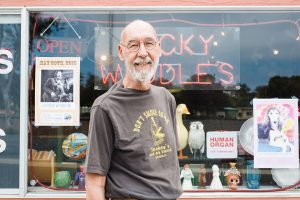 Jerry Waddle stands in front of his Leucadia shop, Ducky Waddles, on May 29, 2015. At the time, Encinitas residents organized a cash mob to help keep the store afloat. (NCC file photo by Jen Acosta)