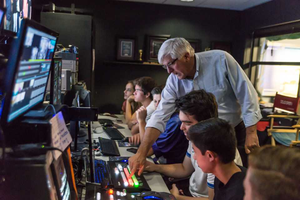 CHSTV adviser Doug Green instructs students before a live broadcast on Oct. 13 at Carlsbad High School. (Photo by Troy Orem)