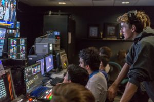 Carlsbad High School Senior Devin Van Siclen (right) oversees a rehearsal of a Carlsbad High School Television (CHSTV) program on Oct. 13. Van Siclen is the acting show producer, guiding the switching between cameras and the cueing of footage. (Photo by Troy Orem)