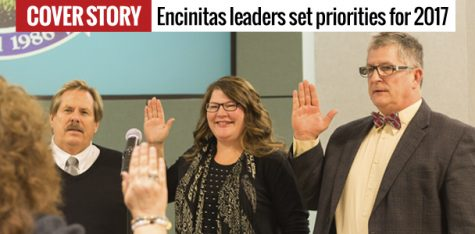 Encintas City Council members Mark Muir (left), Tasha Boerner Horvath and Tony Kranz are sworn in by City Clerk Kathy Hollywood on Dec. 13. (Photo by Cam Buker)