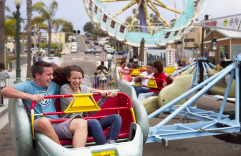 Visitors enjoy a ride at the Encinitas Spring Street Festival on April 28, 2013. (NCC file photo by Scott Allison)