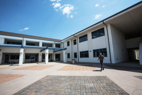 A faculty member walks across the courtyard of San Dieguito High School Academy's new math and science building Aug. 31. The complex opened with the start of the Encinitas campus' fall term. (Photo by Jen Acosta)