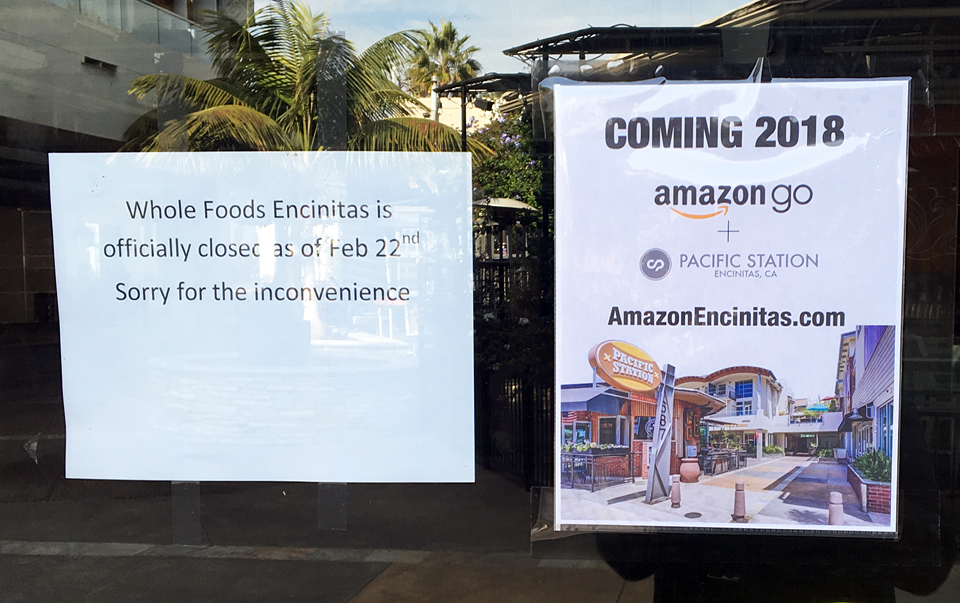 A sign attached to the door of the former Whole Foods Market in downtown Encinitas at the start of November announces the 2018 opening of an Amazon Go store in the space. The sign and a related website, which is no longer active, are reportedly incorrect. (Photo courtesy of Encinitas 101 MainStreet Association)