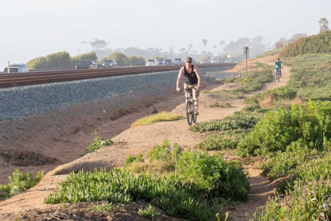 Bicycle riders use a path alongside the rail line in Cardiff. (NCC file photo by Jen Acosta)