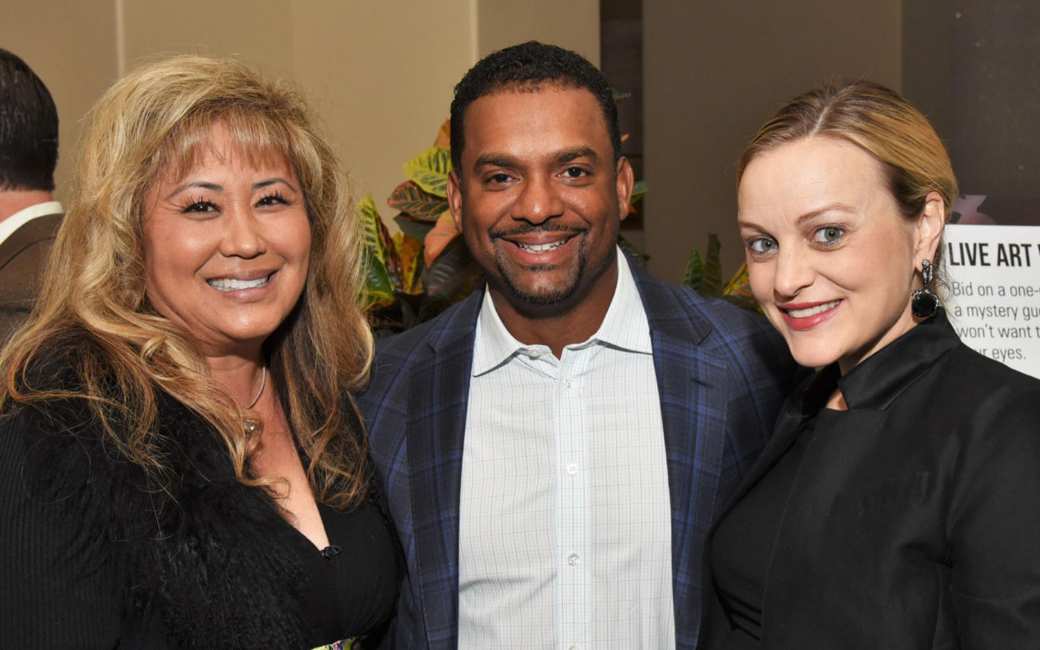 Fresh Start Surgical Gifts CEO Shari Brasher (left) stands with actor Alfonso Ribeiro and Angela Ribeiro (right) on March 3 during the 27th Annual Celebrity Golf Classic fundraiser. (Photo by William Quiroz, WMQuiroz Photography)