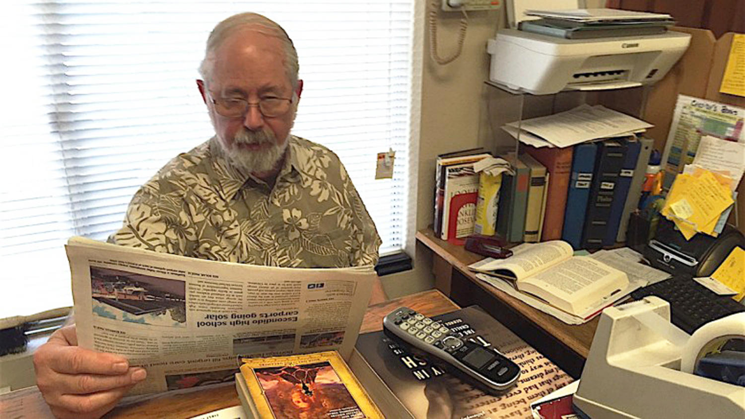 Cassidy's Books owner Tom McDevitt works at his desk in the shop, located in San Marcos. (Escondido Grapevine photo)