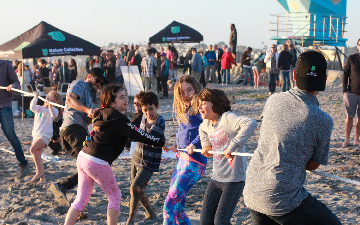 Kids lean in to a game of tug-of-war on the sands at Seaside Beach in Cardiff during the Nature Collective's unveiling celebration on May 17. (Nature Collective photo)