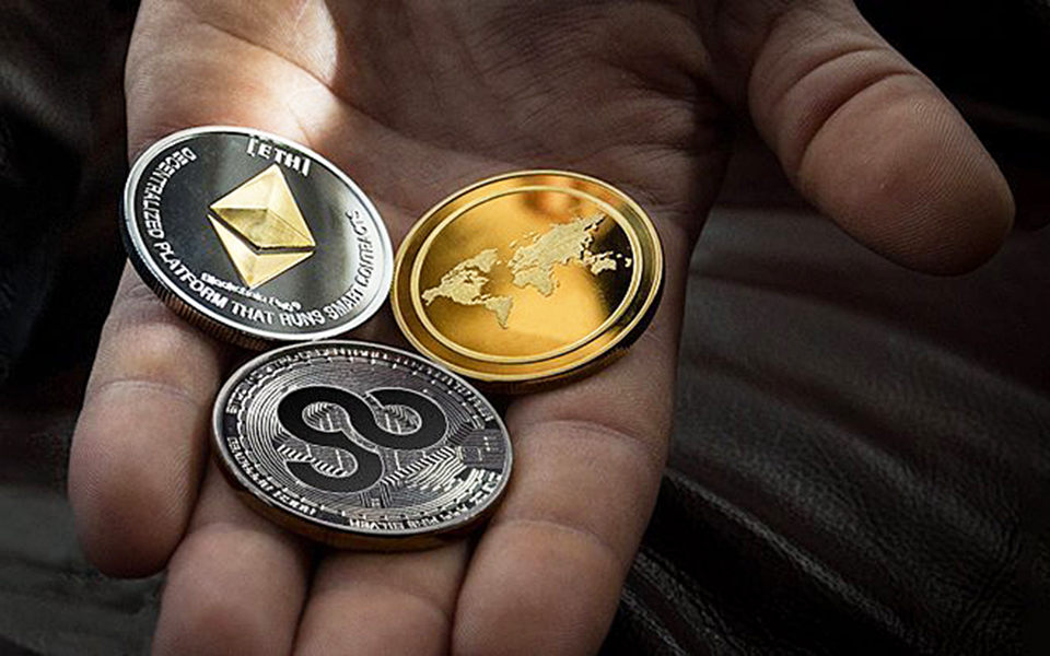 An example of AirGo Miles' cryptocurrency (below the two other coins) is shown in a company handout. (AirGo photo)