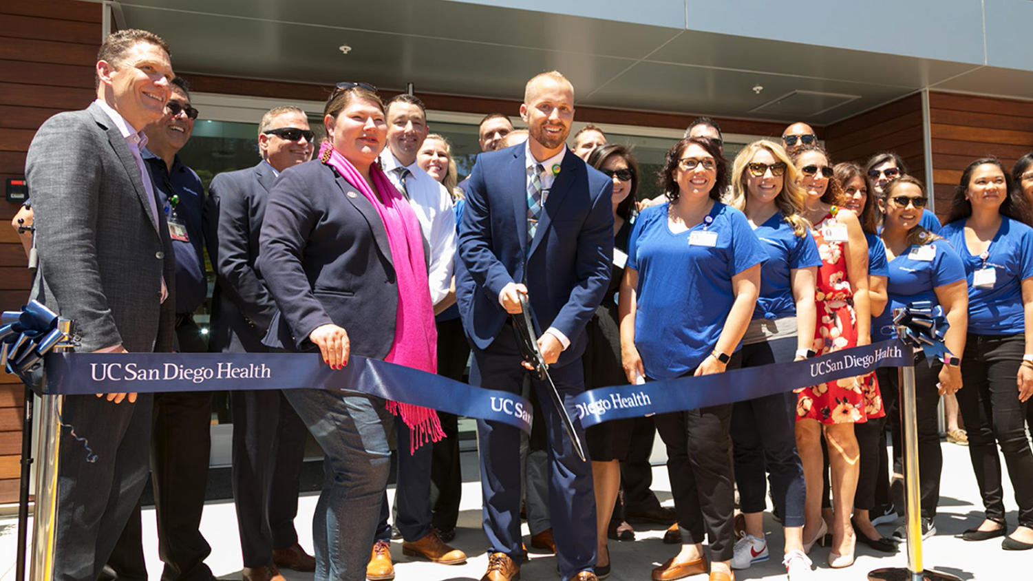Dr. Christopher Kane, UC San Diego Health Physician Group CEO (far left); state Assemblywoman Tasha Boerner Horvath, D-76th District (second from left, holding ribbon), and Kevin Schwerdtfeger, regional practice manager (holding scissors) celebrate the opening of UC San Diego Health's new Encinitas health center on June 10 with other facility officials and employees. (UC San Diego Health photo)