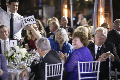 Philanthropist Darlene Marcos Shiley raises her paddle during Cal State San Marcos' annual fundraising gala on June 8. At the event, Shiley announced that she has donated $2.6 million to the CSU Institute for Palliative Care. (CSUSM photo by Andrew Reed)