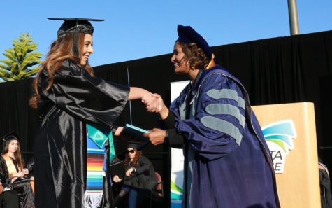 MiraCosta College President Sunita Cooke (right) congratulates a graduate May 24 at the Oceanside campus. (MiraCosta photo by Alex Karvounis)