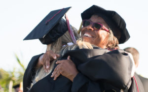 Palomar College President Joi Lin Blake hugs a graduate during commencement ceremonies May 24 at the San Marcos campus. (Palomar College photo)