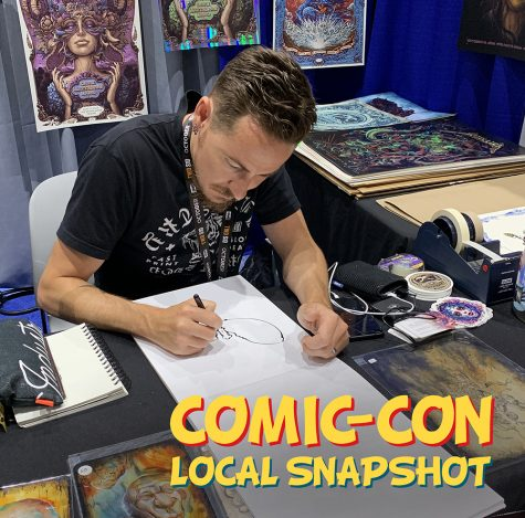Carlsbad artist N.C. Winters draws a sketch for fan Susie Lum of La Mirada at his Comic-Con booth. The convention ran July 18-21 in downtown San Diego. (Photo by Meghan Lanigan)