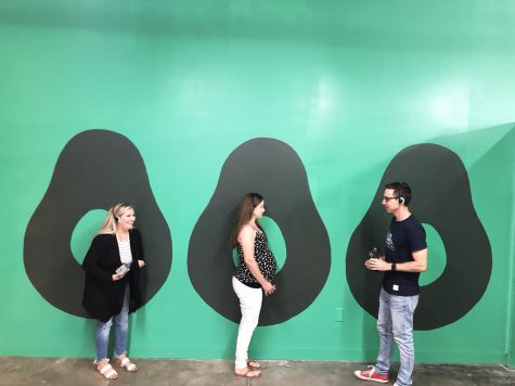 Joanna Rossoni, Briana Fillmore and Sam Bouffard participate in activities at The CADO museum in San Marcos on July 6. The pop-up museum is dedicated to the avocado. (CADO Museum photo)