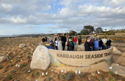 Visitors tour the Harbaugh Seaside Trails donor monument at sunset Feb. 22. The trails are located at the southwest end of San Elijo Lagoon in Solana Beach. (Nature Collective photo)