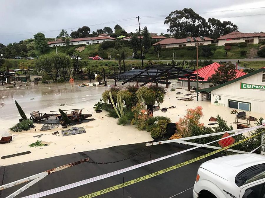 Flooding from heavy rain reaches the driveway and halfway up the windows of the Sunshine Gardens property in Encinitas on Friday, April 10. (Sunshine Gardens photo)