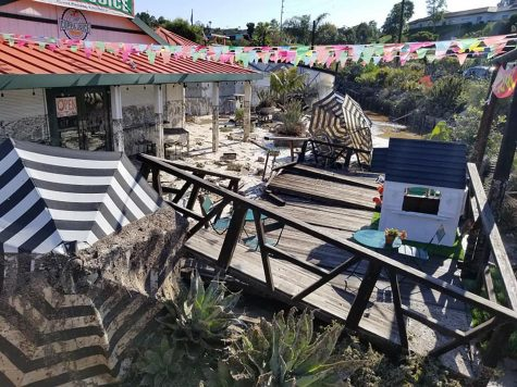 A deck sits destroyed in front of Cuppa Juice on the Sunshine Gardens property in Encinitas on Saturday, April 11, after a major flood the day before. (Sunshine Gardens photo)
