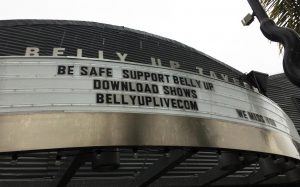 """The Belly Up Tavern in Solana Beach declares """"We Miss You"""" to the community on a rainy Friday, April 10. The music venue is among numerous businesses shuttered during the COVID-19 coronavirus pandemic. (Photo by Roman S. Koenig)"""
