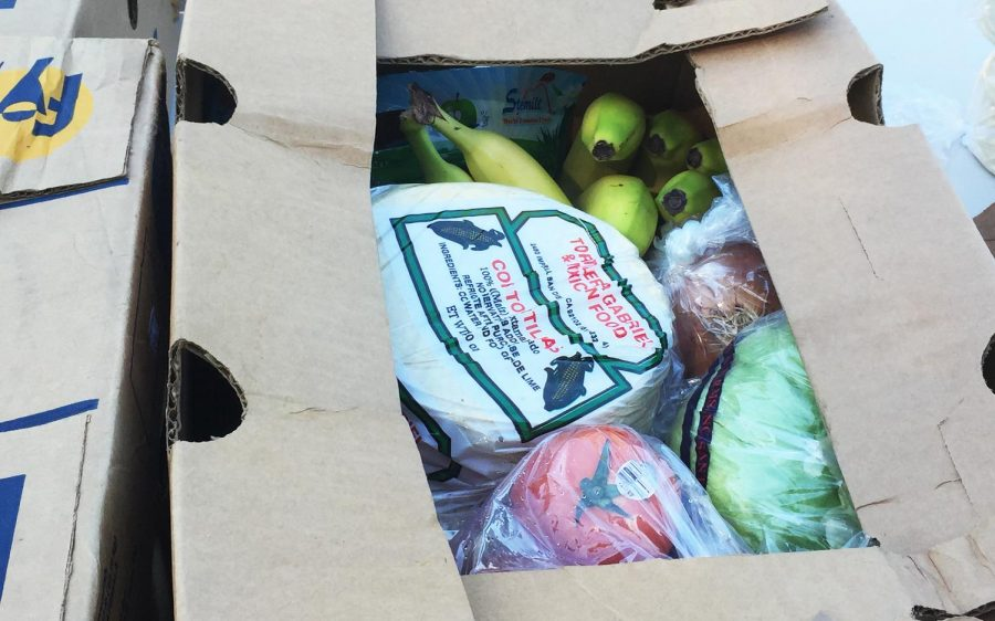 A box of food is prepared for a family in need on Wednesday, April 15, during an effort by La Colonia de Eden Gardens in Solana Beach. The boxes were handed out for families affected by the COVID-19 coronavirus crisis. (Courtesy photo)