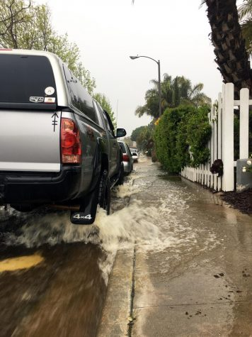 Water rushes downhill north on Cerro Street in Encinitas on Friday afternoon, April 10, as rain inundated San Diego County. (Photo by Roman S. Koenig)