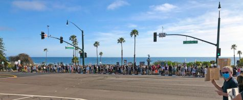 About 200 Encinitas residents gather at the Cardiff Kook statue May 31 to add their voices to growing nationwide protests over the death of an African-American man in Minneapolis police custody. (Photo courtesy of Scott Chatfield)