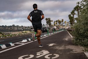 A jogger runs on a new lane dedicated for cyclists through Cardiff in Encinitas, pictured looking south on Wednesday, June 10. (Photo by Jen Acosta)