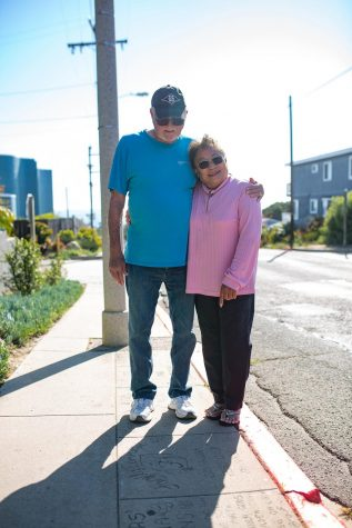 Cardiff residents Jay and Haruko Meinhardt stand at their Own a Piece of the Walk tile on Birmingham Drive on April 28. (Photo by Jen Acosta)