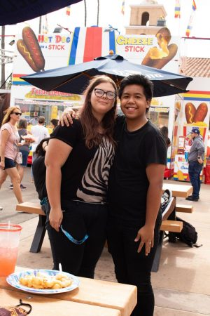 """Vanessa Caldwell, 19, and Marvin Fajotina, 20, returned to the San Diego County Fair on June 23 to celebrate their two-year anniversary as a couple. """"She actually asked me out at the fair two years ago, so that's why we come to the fair,"""" Fajotina said. """"It's our anniversary thing."""" (Photo by Bella Ross)"""