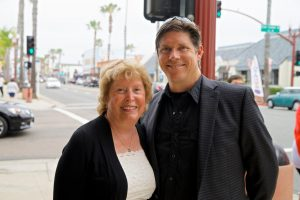 Ann and David Schulz, mother and son team of The Star Theatre in Oceanside, are pictured July 3, 2015, at the venue's marquee dedication. (NCC file photo by Troy Orem)